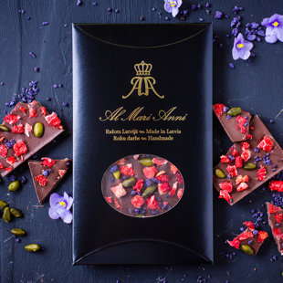 Milk chocolate with freeze-dried strawberries, pistachios and violets