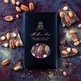 Dark chocolate with handpicked pecans, hazelnuts, almonds and edible gold