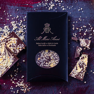 Dark chocolate with flavoured lemon zest and peculiar patterns of white chocolate