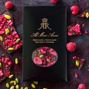 Milk chocolate with freeze-dried raspberries and handpicked pistachios
