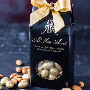 Mandeles tumšajā šokolādē pārklātas ar pārtikas zeltu 24K