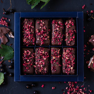 Black currant marshmallow covered in dark chocolate